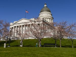 (Leah Hogsten  |  The Salt Lake Tribune)  People walks the path around the Utah Capitol and recreate on the grounds, April 4, 2020.