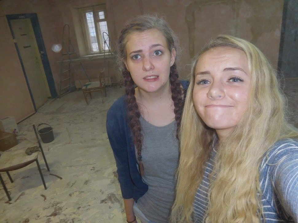 | Courtesy Sariah Warnick Sariah Warnick with her companion during a service project, helping spackle and paint, at a center for the blind in Saratov.