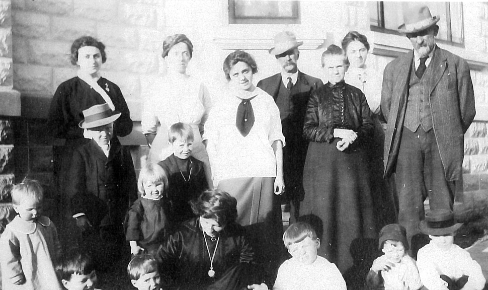 (photo courtesy Susan Leiber) Lawrence E. Leea, on the left wearing a hat, is seen as a young boy with his family.