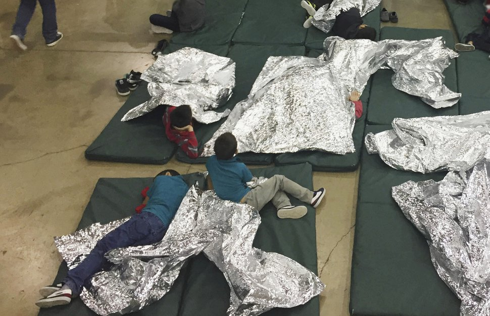 In this photo provided by U.S. Customs and Border Protection, people who've been taken into custody related to cases of illegal entry into the United States rest in one of the cages at a facility in McAllen, Texas, Sunday, June 17, 2018. (U.S. Customs and Border Protection's Rio Grande Valley Sector via AP)