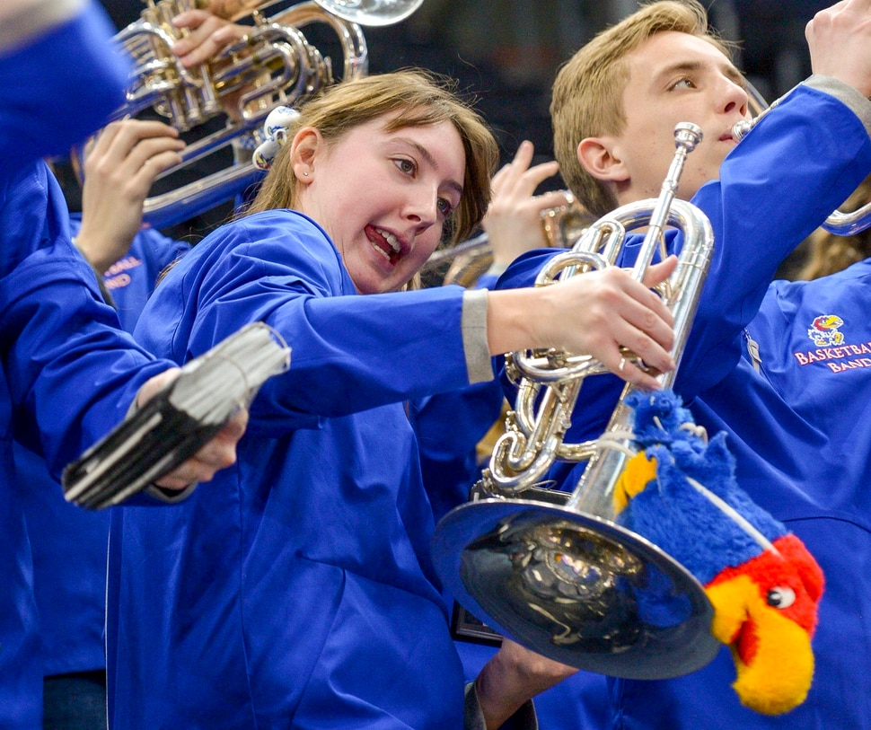 Leah Hogsten | The Salt Lake Tribune Jayhawk basketball band player Rachel Gibbs dances during Wednesday's practice time at Vivint Smart Home Arena. The Kansas Jayhawks take the court during the 2019 NCAA Division I Men's Basketball Championship, March 20, 2019 in preparation for their first round game against the Northeastern Huskies on Thursday.