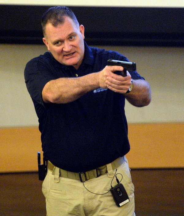 (Rick Egan | Tribune File Photo) Clark Aposhian gives instructions during a free concealed firearms permit class to Utah educators at the Salt Lake City Library, Friday, January 3, 2014.