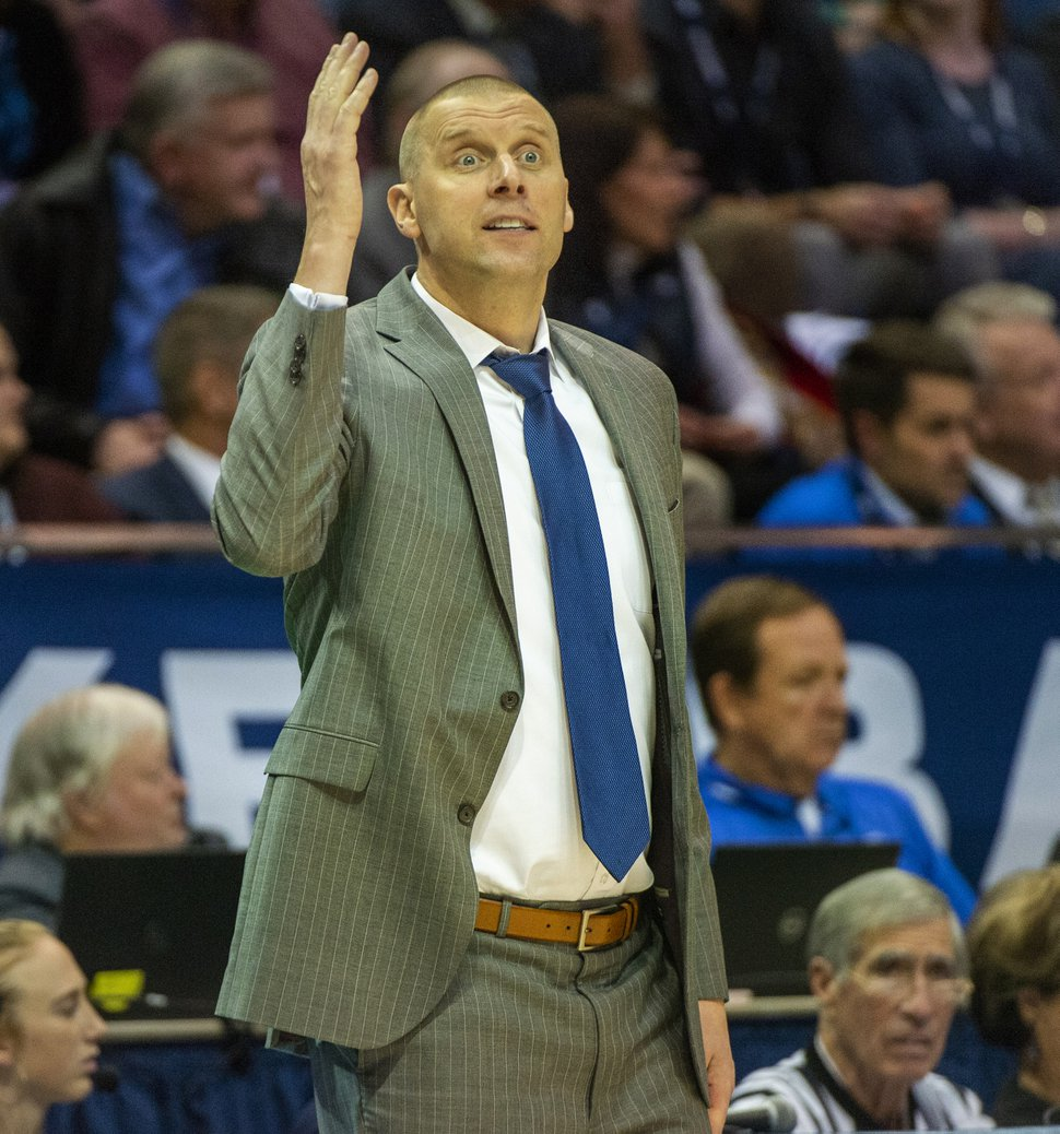 (Rick Egan   The Salt Lake Tribune) Brigham Young Cougars head coach Mark Pope shouts instructions to his players in basketball action between the Brigham Young Cougars and the Nevada Wolf Pack at the Marriott Center in Provo, Tuesday, Dec. 10, 2019.