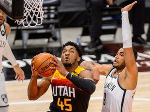 (Trent Nelson  |  The Salt Lake Tribune) Utah Jazz guard Donovan Mitchell (45) scores ahead of Brooklyn Nets guard Timothe Luwawu-Cabarrot (9) as the Utah Jazz host the Brooklyn Nets, NBA basketball in Salt Lake City on Wednesday, March 24, 2021.
