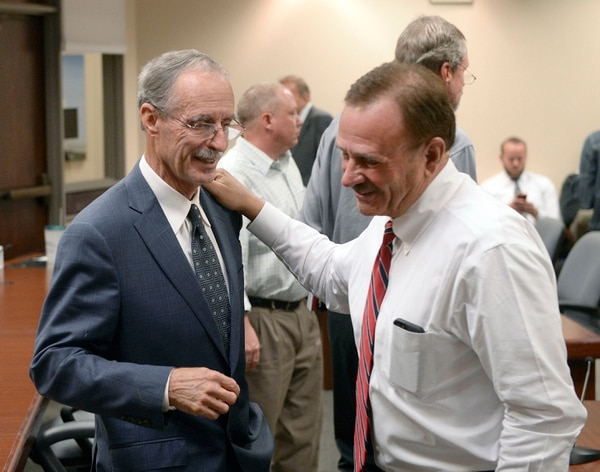 Al Hartmann | The Salt Lake Tribune Salt Lake County Council Chair Max Burdick, right, pats the shoulder of Salt Lake County County Recorder Gary Ott after he spoke on findings of the County Auditor's performance audit of his office Tuesday Oct. 4.
