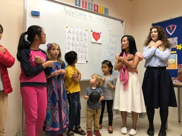 (Mike Stack for The Salt Lake Tribune) Sister missionaries Thuy Anh and Reagan Moss teach Primary song in sign language in Hanoi LDS branch.