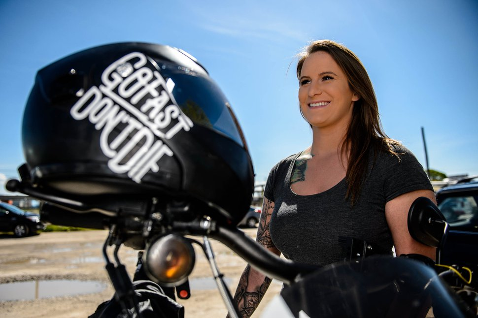 (Trent Nelson | The Salt Lake Tribune) Lindsay Ross with her motorcycle at Bill's Boneyard in West Valley City on Tuesday, April 23, 2019. Ross recounted her experience surviving a motorcycle crash at a news conference by UDOT and Utah Highway Patrol addressing a big increase in motorcycle deaths.