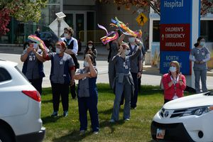 (Francisco Kjolseth  |  The Salt Lake Tribune) First responders do a drive by the University of Utah Hospital, Primary Children's and IMED in Salt Lake City on Monday, April 27, 2020, as caregivers come outside to exchange thanks in the midst of the COVID-19 pandemic.