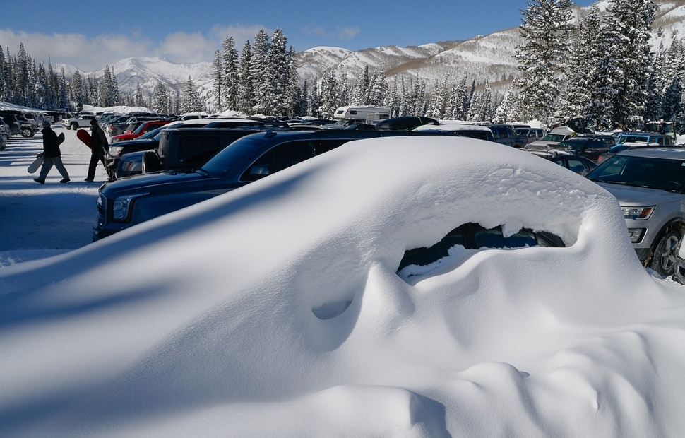 (Francisco Kjolseth | The Salt Lake Tribune) A buried car reveals the snow accumulations in the high country as people enjoy a blue bird day at Solitude Mountain Resort on Thursday, Feb. 7, 2019.