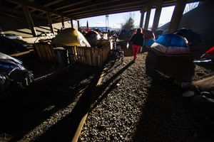 (Rick Egan   Tribune file photo) State lawmakers voted this week on whether to set aside funding for an overflow homeless shelter in Salt Lake City. Camp Last Hope, a former encampment, was built on abandoned railroad tracks under the freeway. Tuesday, Jan. 5, 2021.