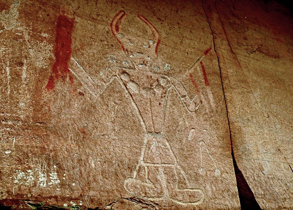 (Erin Alberty|The Salt Lake Tribune) Fremont petroglyphs show a character wielding what appears to be a bloody weapon at McConkie Ranch in Dry Fork Canyon near Vernal. Photo taken July 23, 2009.