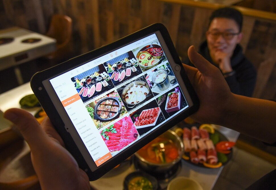 (Francisco Kjolseth | The Salt Lake Tribune) A tablet is used to make menu selections at KungFu Hotpot, a new restaurant at 1465 S. State St. in Salt Lake City that specializes in Chinese hotpot cooking.