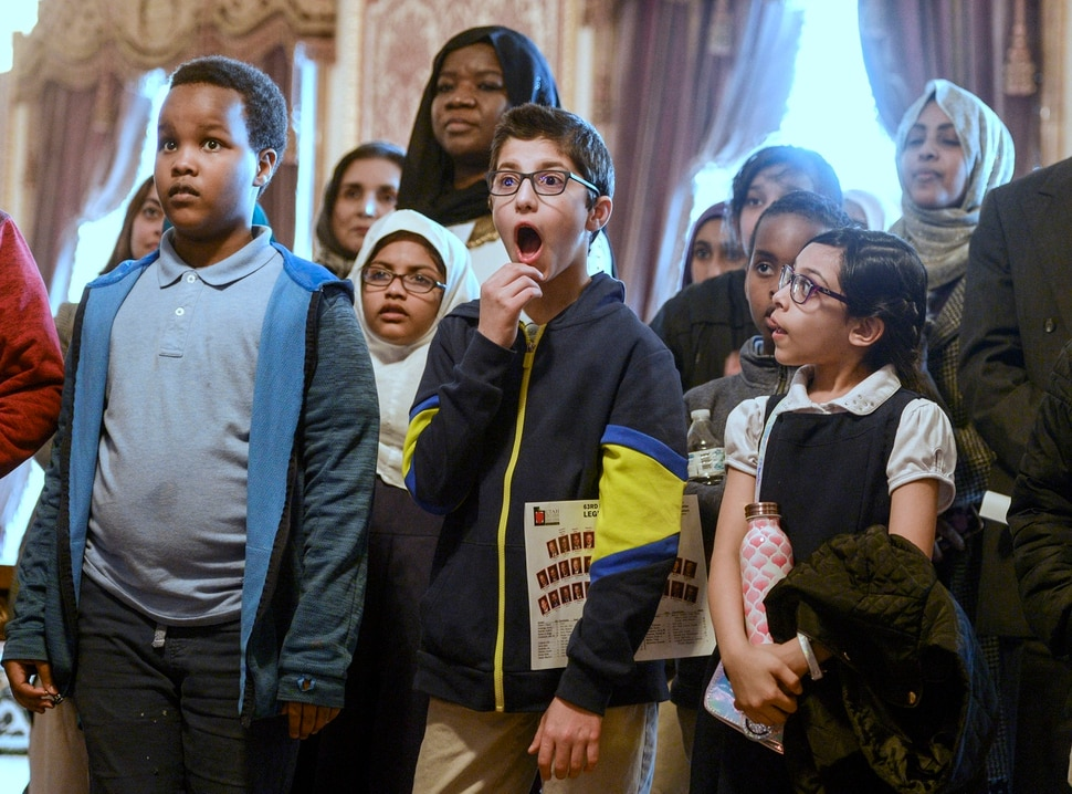 (Leah Hogsten | The Salt Lake Tribune) l-r Iqra Academy of Utah students Khairdon Mohamed, Aysha Rufaidha, Mohamed Hassoun and Ansharah Khan react to learning the age of the Capitol building during their first tour. Members of the Muslim community, students from Iqra Academy of Utah and members of the Utah Muslim Civic League tour the Capitol during the inaugural Muslim Day on the Hill, Feb. 25, 2020.