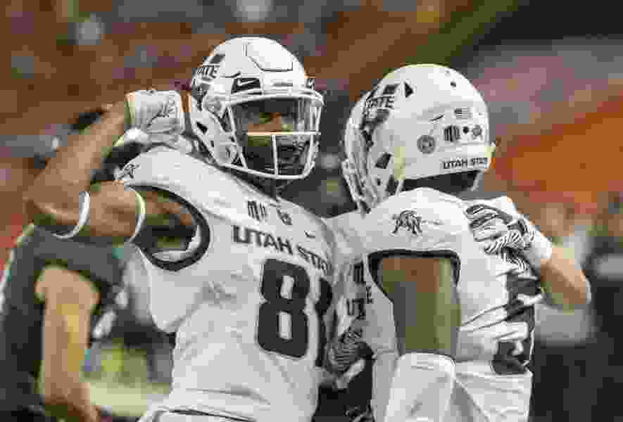 No. 18 Utah State routs Hawaii 56-17 for its eighth consecutive win