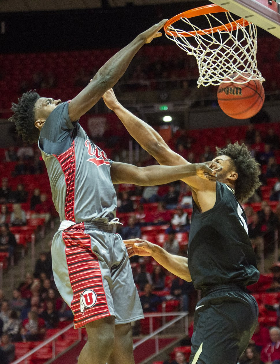 (Rick Egan | The Salt Lake Tribune) Utah Utes forward Donnie Tillman (3) dunks the ball over Colorado Buffaloes guard D'Shawn Schwartz (5), in PAC-12 basketball action between the Utah Utes and the Colorado Buffaloes at the Jon M. Huntsman Center, Sunday, Jan. 20, 2019.