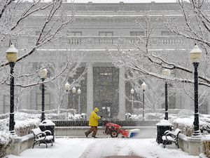 (Francisco Kjolseth     The Salt Lake Tribune) Carlos Williams clears the walkways around the Capitol as a fresh batch of snow falls on Salt Lake City on Tuesday, Jan. 13, 2020.