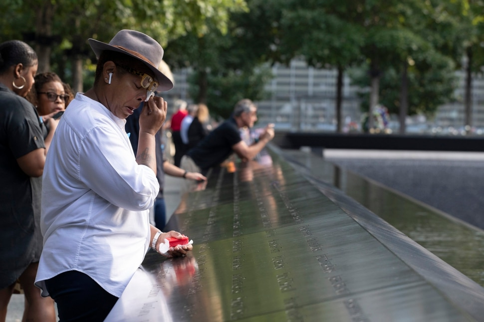 (Mark Lennihan   AP Photo) A woman wipes away tears as she stands next to the north pool prior to a ceremony marking the 18th anniversary of the attacks of Sept. 11, 2001 at the National September 11 Memorial, Wednesday, Sept. 11, 2019 in New York.