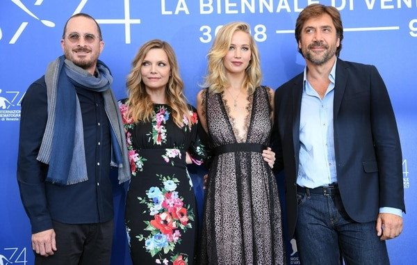 From left, US film director Darren Aronofsky, actresses Michelle Pfeiffer, Jennifer Lawrence and Spanish actor Javier Barden pose during a photocall for the movie 'Mother!' at the 74th annual Venice International Film Festival, in Venice, Italy, Tuesday, Sept. 5, 2017. (Claudio Onorati/ANSA via AP)