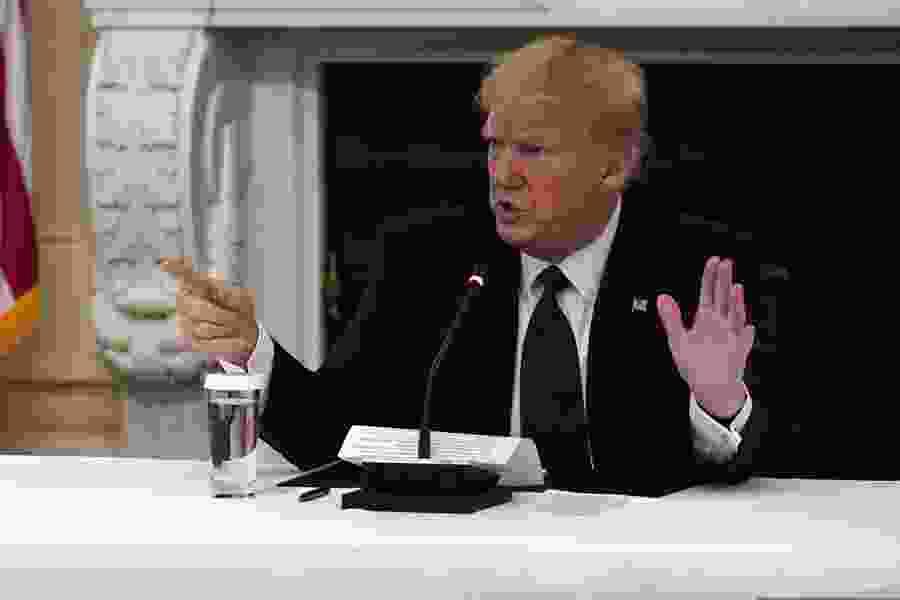 Despite risks, Trump says he's taking hydroxychloroquine