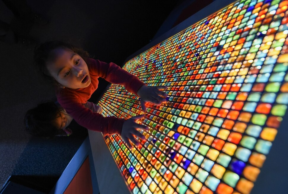 (Francisco Kjolseth | The Salt Lake Tribune) Ryder Motuli, 6, who is on the autism spectrum, connects with the colors and the tactical feeling of movable marbles on a light panel in the sensory room at Discovery Gateway. The children's museum has been certified as a sensory-inclusive space for children on the autism spectrum - by offering quiet areas and sensory bags with headphones, fidget toys and other ways to help kids on the spectrum cope with unfamiliar, noisy surroundings.