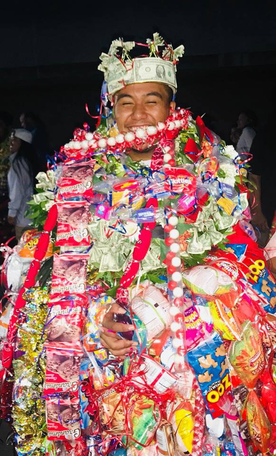 (Courtesy of M. Vida Hafoka) Taavili PO Hafoka graduated from East High School in Salt Lake City on Wednesday, June 6, 2018. He has South Pacific heritage but was banned from wearing leis during his ceremony at the Huntsman Center. Pacific Islander students, when allowed, typically wear one or two fresh leis during their graduation to honor their heritage. Relatives then pile more on after the ceremony, in celebration.