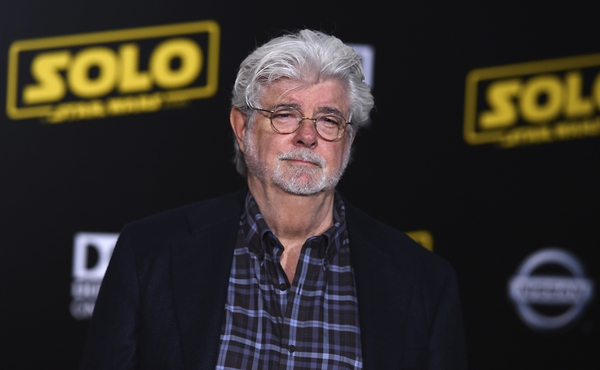 George Lucas arrives at the premiere of
