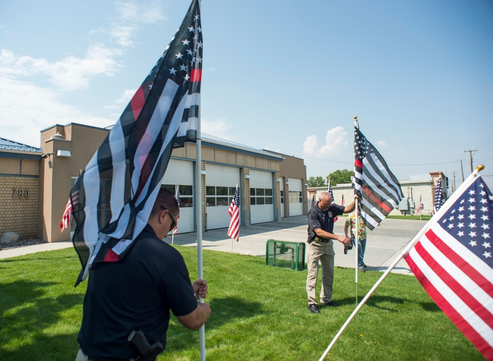 (Rick Egan | The Salt Lake Tribune) Thin Red line flags are posted at the Draper Fire Station in memory of Draper firefighter Matt Burchett, 42, who died fighting wildfires in California. Tuesday, Aug. 14, 2018.