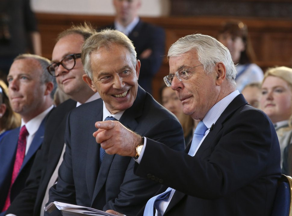 Former British prime ministers Sir John Major, right, and Tony Blair share a platform for the Remain campaign at the University of Ulster in Londonderry. Northern Ireland, Thursday June 9, 2016. Britain's referendum on EU membership will take place on Thursday June 23. (Brian Lawless/PA via AP) UNITED KINGDOM OUT NO SALES NO ARCHIVE