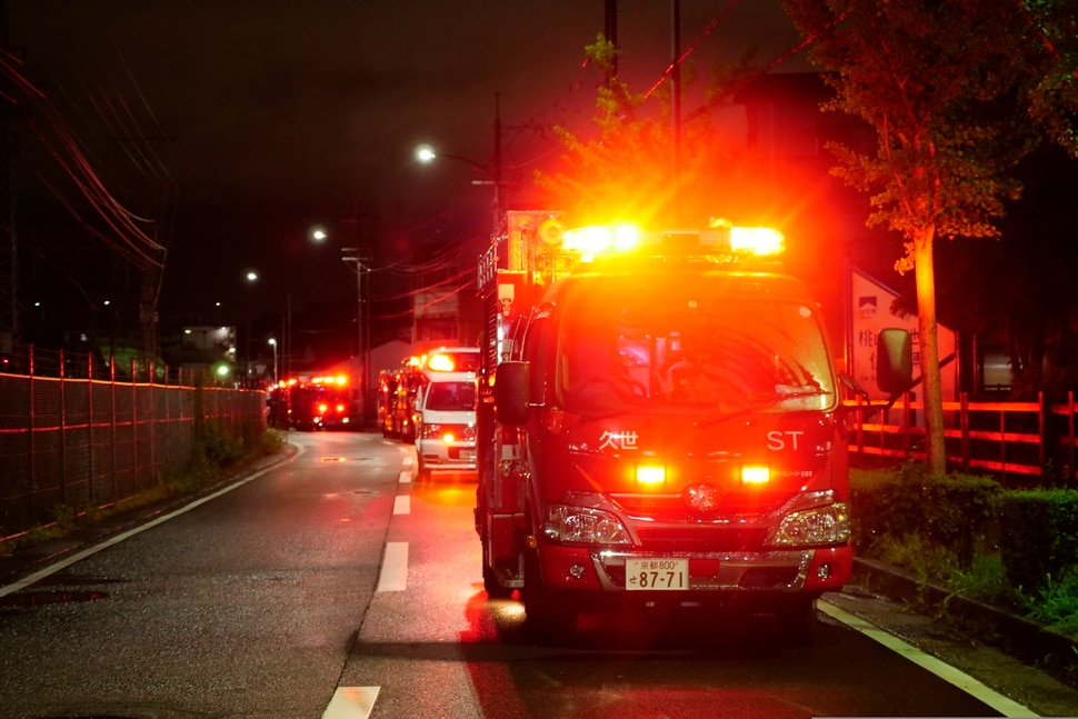 (Hiromi Tanoue   AP Photo) A fire engine stands by near the building of Kyoto Animation following a fire in Kyoto, western Japan, Thursday, July 18, 2019. The fire broke out in the three-story building in Japan's ancient capital of Kyoto, after a suspect sprayed an unidentified liquid to accelerate the blaze, Kyoto prefectural police and fire department officials said.