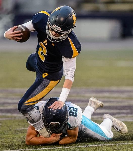 (Trent Nelson | The Salt Lake Tribune) Summit Academy quarterback Haden Reynolds is brought down by Juan Diego's Tristen Tonozzi. Summit Academy faces Juan Diego High School in a class 3A state semifinal football game at Weber State University's Stewart Stadium, Saturday November 4, 2017.