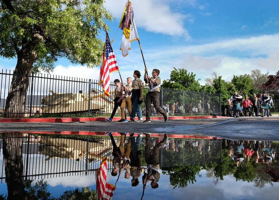 (Francisco Kjolseth | The Salt Lake Tribune) Boy Scout Troop 1332 from Murray leads the Memorial Day march from Fort Douglas Museum on the University of Utah campus to Fort Douglas cemetery on Monday, May 27, 2019.