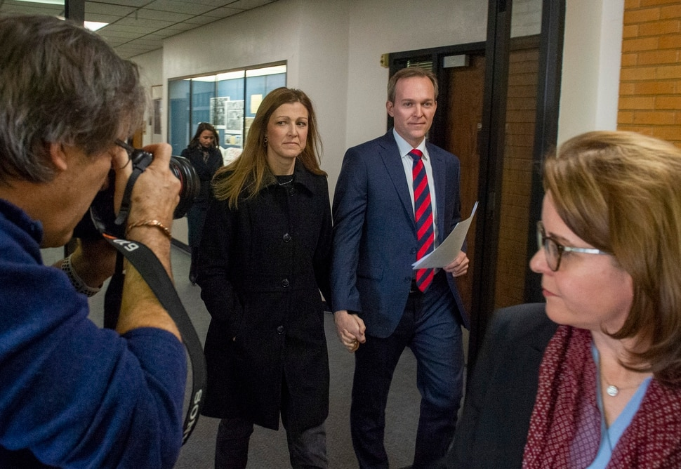 (Rick Egan | The Salt Lake Tribune) Ben McAdams leaves with his wife, Julie, after announcing that he will vote yes on the House impeachment vote, during news conference at Murray City Hall, Monday, Dec. 16, 2019.