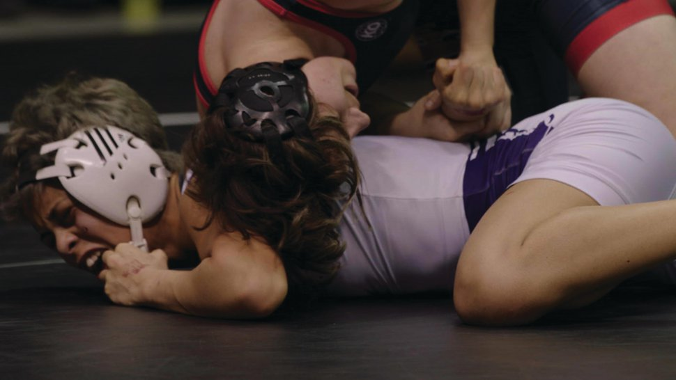 (Turner Jumonville | Courtesy of Superfilms!) Mack Beggs, top, wrestles for the Texas girls state championship, in a moment from the documentary