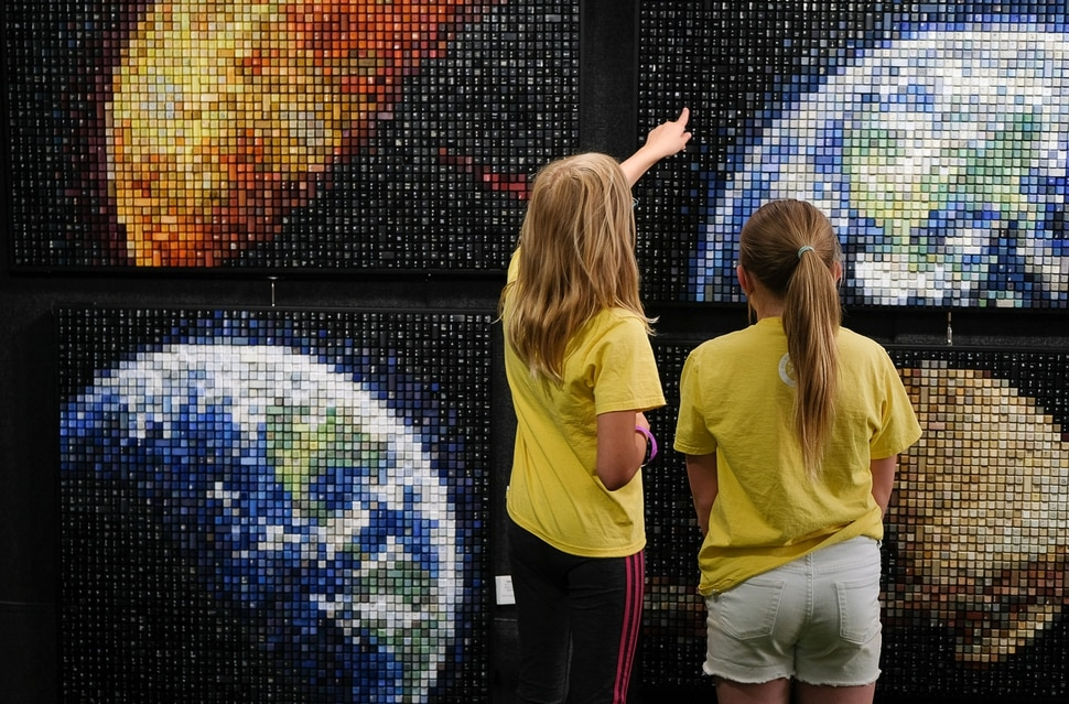 (Francisco Kjolseth | The Salt Lake Tribune) Kids admire the detail in Erik Jensen's works made up entirely of recycled keyboard keys during the annual 2019 Utah Arts Festival as it kicks off at Library Square and Washington Square in downtown Salt Lake City, Thursday, June 20, 2019, with visual and performance art of all varieties and food for all ages from June 20-23.