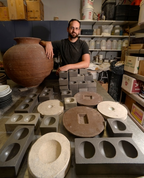 (Scott Sommerdorf | The Salt Lake Tribune) Clark Marshall poses with some of his ceramic dinnerware. His creations also are used at some of Utah's best restaurants, and have been featured in national food magazines. His work will be part of an Art Access Gallery Show, called