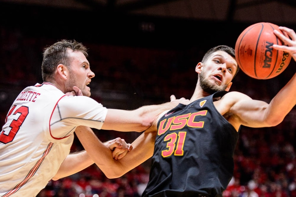 (Trent Nelson | The Salt Lake Tribune) Utah Utes forward David Collette (13) and USC Trojans forward Nick Rakocevic (31) as the University of Utah hosts USC, NCAA basketball at the Huntsman Center in Salt Lake City, Saturday Feb. 24, 2018.