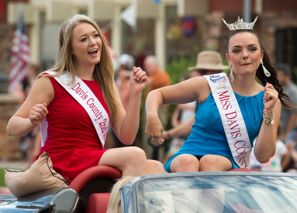(Rick Egan | The Salt Lake Tribune) Second Attendant Izabelle Reece and Miss Davis County, Sasha Sloan dance to the music in the 65th annual Bountiful Handcart Days Parade, Friday, July 20, 2018.