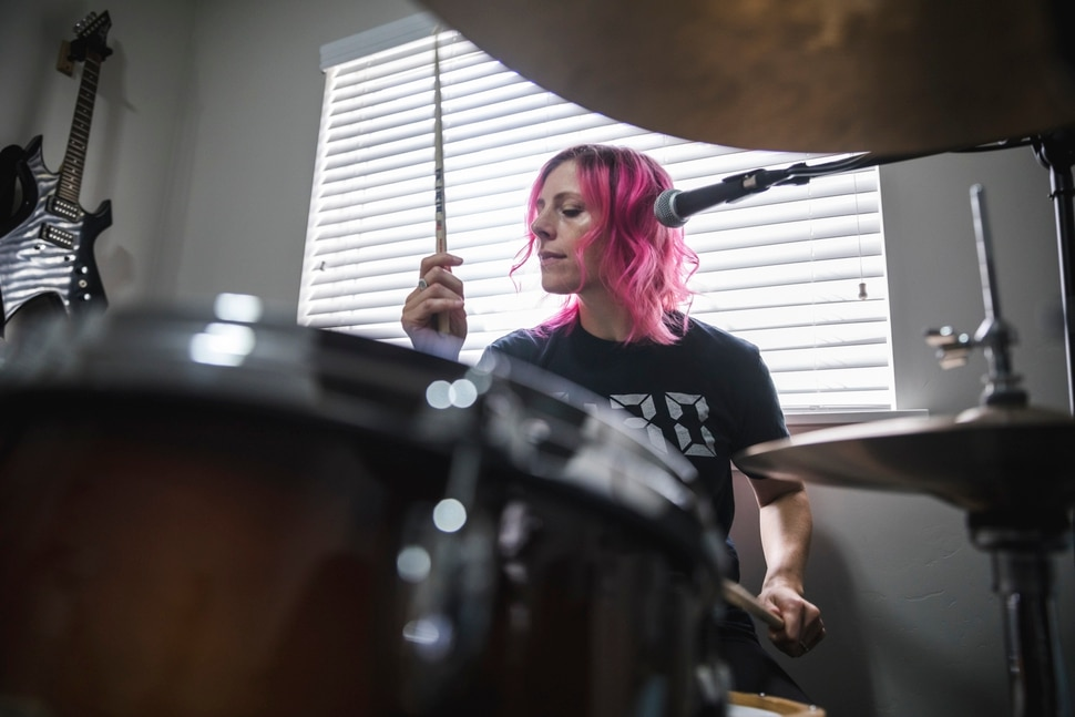 (Clark Clifford | For The Salt Lake Tribune) Elaine Bradley of Noble Bodies drumming during a practice for an upcoming show in the band's rehearsal space in Orem on Saturday, Aug. 3, 2019.