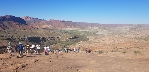(Courtesy Jenny McKinsey) Hikers walk to Delicate Arch at 10 a.m. on Sunday, May 27.