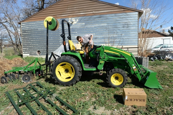 (Steve Griffin | Tribune file photo) Marty Alston fires up the tractor at one of their plots of farm land in Draper. Marty and his wife, MaryAnn Alston, are an urban farming family, planting more than 200 varieties of vegetables from arugula to zucchini on plots in Murray, Draper, Holladay and West Valley City.