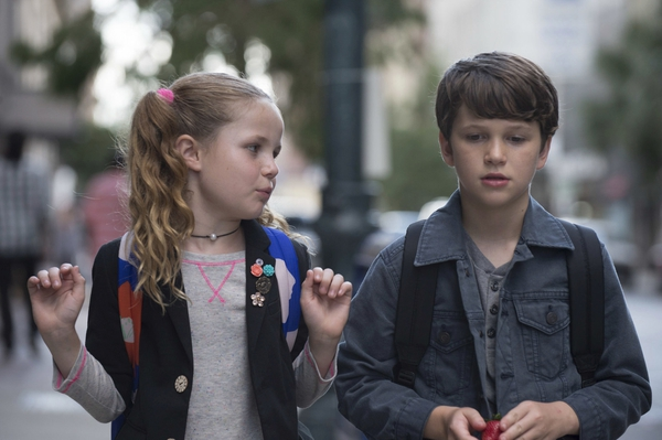 This image released by Netflix shows Darby Camp, left, and Gabriel Bateman in a scene from