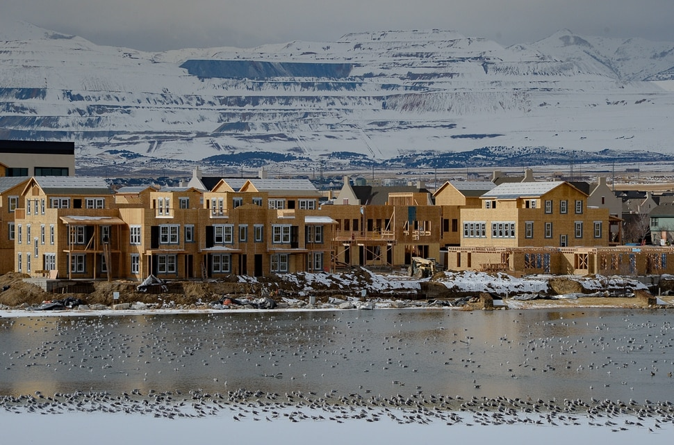 (Francisco Kjolseth | The Salt Lake Tribune) The Kennecott Copper Mine is seen in the background as ongoing development takes shape around Oquirrh Lake at Daybreak on Thursday, Jan. 9, 2020. Daybreak, the 4,100-acre master planned community in South Jordan, illustrates the idea of blending higher density housing and walkable community design with ample amounts of open space. That smart growth land use approach is being required by Salt Lake County for a proposed development called Olympia Hills, a 933-acre residential and commercial project proposed west of Herriman.