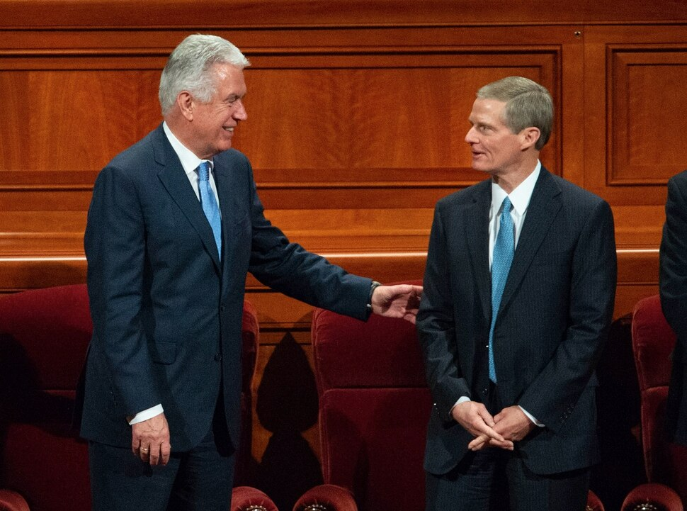 (Keith Johnson | Special to The Tribune) Elder Dieter F. Uchtdorf, left, talks with Elder David A. Bednar before singing a rest hymn during the 188th Semiannual General Conference of The Church of Jesus Christ of Latter-day Saints on Oct. 7, 2018 in Salt Lake City.