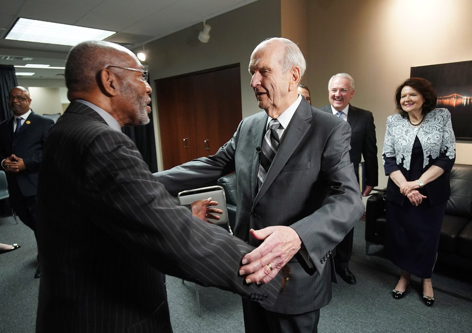 (Courtesy of The Church of Jesus Christ of Latter-day Saints) LDS Church President Russell M. Nelson and his wife, Wendy, are greeted by NAACP President and CEO Derrick Johnson at the NAACP's 110th annual national convention in Detroit on Sunday, July 21, 2019.