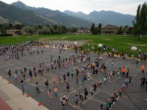 (Francisco Kjolseth     The Salt Lake Tribune) Students at Canyon View Elementary in Cottonwood Heights line up on the playground as they go back to school for the first day of classes for the Canyons School District on Monday, August 24, 2020, with parents asked to stay back on the playground lawn while they wait for first bell.