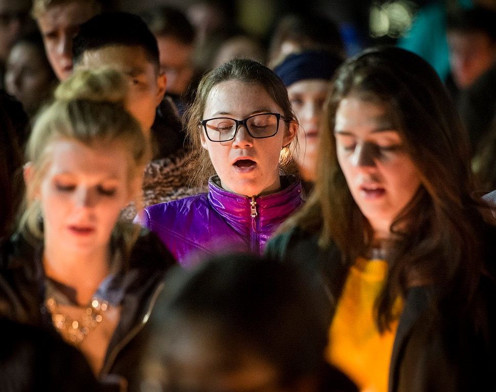 Michael Mangum | Special to the Tribune Carolina Herdegen, center, a senior at BYU, and other students sing hymns during a candlelight vigil held outside the N. Eldon Tanner Building on the campus of BYU in Provo, UT on Wednesday, December 5th, 2018.