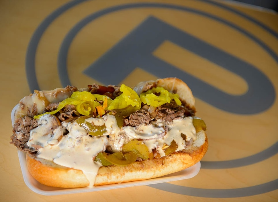 (Trent Nelson | The Salt Lake Tribune) Cheesesteak with provolone, mushrooms, onions, peppers, and spicy mayo on top. Fat Boy Phillies, a popular new sandwich shop in Murray, Monday July 23, 2018.