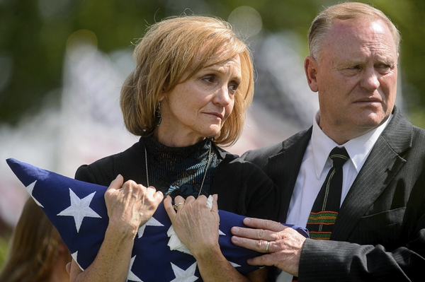 Laura and Randy Butler grieve at the graveside service for their son, fallen soldier Aaron Butler, who was killed in action in Afghanistan earlier in the month, in Monticello, Utah, Saturday, Aug. 26, 2017. (Trent Nelson/The Salt Lake Tribune via AP)