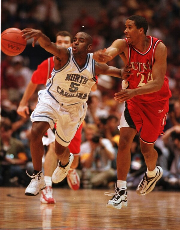 (Trent Nelson | The Salt Lake Tribune) North Carolina's Ed Cota (5) and Utah's Andre Miller in action at the 1998 Final Four game in San Antonio, Texas.