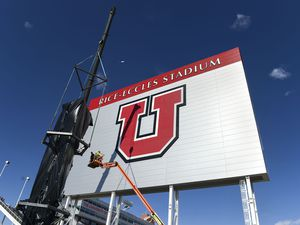 (Leah Hogsten  |  The Salt Lake Tribune)  Workers with Layton Construction and Mountain Crane began dismantling the 2002 Winter Olympic Cauldron located on the University of Utah's Rice-Eccles Stadium complex, Thursday, Feb. 13, 2020.  As part of the stadium's expansion project, the 19-year old cauldron will be restored to its former brilliance and re-installed on the grounds of Rice-Eccles Stadium, north of the ticket office, in 2021.
